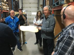 Robert Godin himself led the factory tour. Here he explains bass and treble response in terms of the top wood.